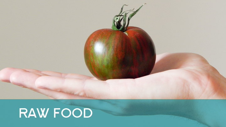 Raw food - tomato in Petrs hand